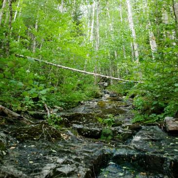 Taking a break at a stream crossing