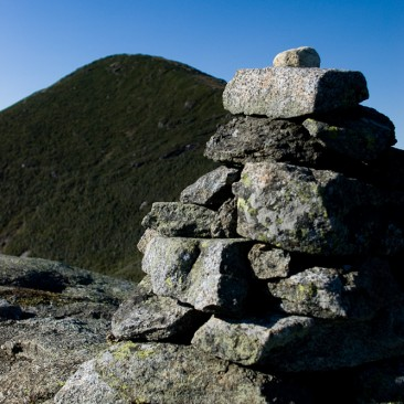 Algonquin looms behind a cairn on Wright Peak