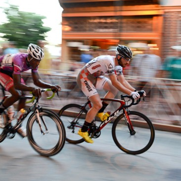 West Chester, PA: The early leaders break away from the peloton during the men's professional race during the West Chester Iron Hill Twilight Criterium, Saturday July 6, 2013.