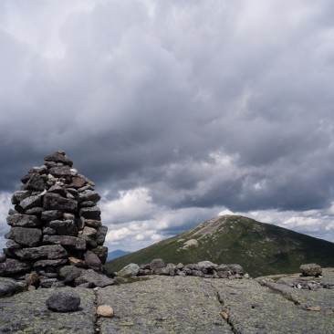 Cairn on Mt. Skylight towards Mt. Marcy