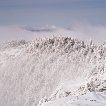 Whiteface Mountain poking out from the clouds