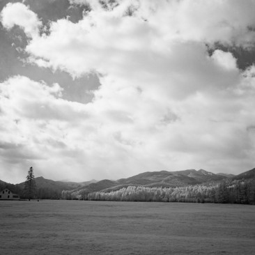 Sun and clouds over Lower WolfJaw Mountain as seen from Marcy Airfield, Keene Valley.