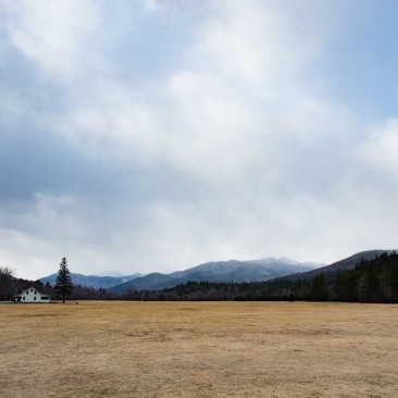 A snow squall passes over Lower WolfJaw Mountain as seen from Marcy Airfield, Keene Valley.