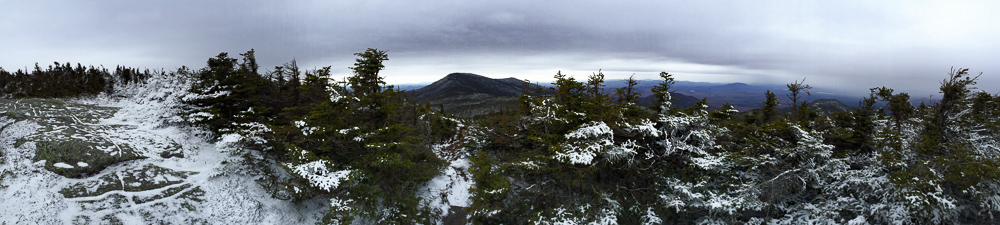 Panoramic view from near the summit of Panther Peak, towards Santanoni Peak (center) and Couchsachraga Peak (right).