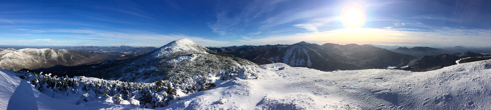 Panoramic view from Iroquois Peak, with Algonquin Peak (left center), Mount Colden (center) and Mount Marcy (center rear).