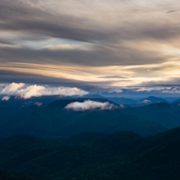 Early morning clouds over MacNaughton (center) and Wallface (center right) Mountains.