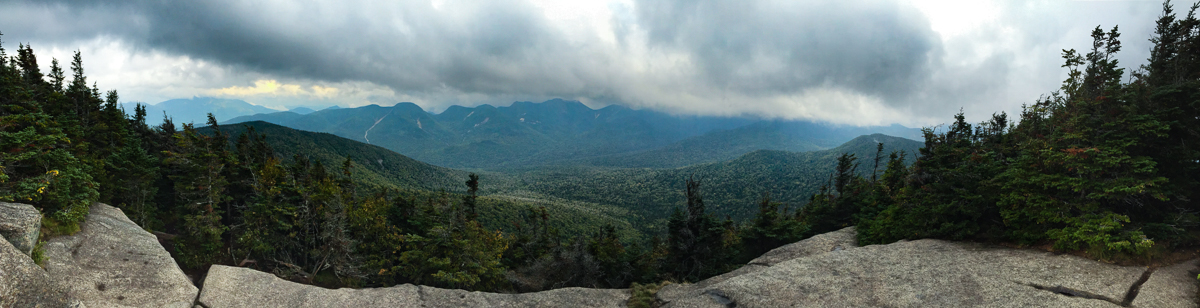 Big Slide vista: (l-r) Giant, Round, Noonmark, Lower WolfJaw, Upper WolfJaw, Armstrong, clouds over upper Great Range