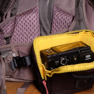 Small camera pack clasped on my EMS bag