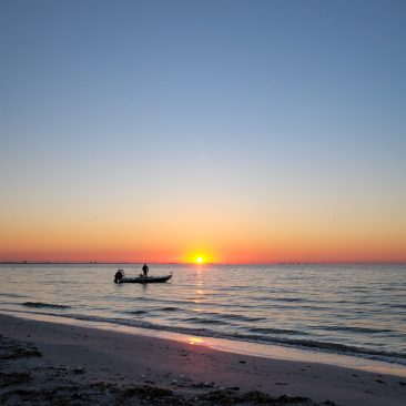 Fisherman at sunrise, Sanibel Island FL